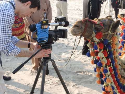 Mark Albert in Karachi photographing a camel