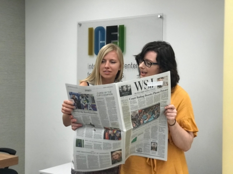 From left to right: Taylor Mulcahey and Samantha Berkhead during a typical day at IJNet.